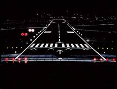 Different Airport Lights Airport Runway At Night Photograph By Lamyl Hammoudi