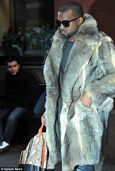 kanye west coats kanye west ruffles feathers again as he steps out in