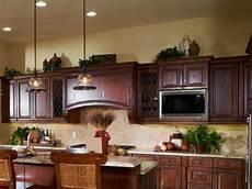 kitchen cabinet decor ideas ideas for decorating above kitchen cabinets lovetoknow