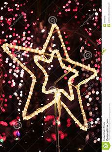 bright star christmas light tester bright christmas star light with bokeh background royalty