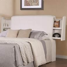white wood california king size headboard a sofa