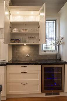 traditional kitchen with windowed overhead cabinets www