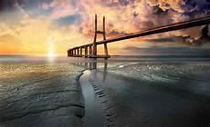 strand solnedgang stad bro strand sol portugal solnedg 229 ng 3144wm