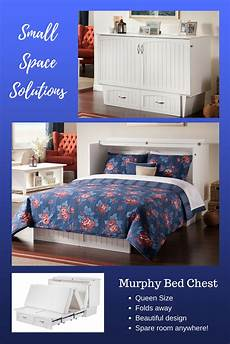 a comfortable bed tucked away in an space saving