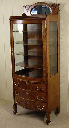small oak curio cabinet with 3 drawers