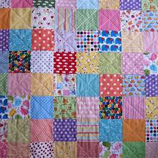 the pink button tree make a patchwork quilt in a weekend