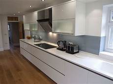 corian wood high gloss white cabinetry with antarctica corian tops