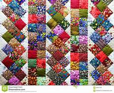 patchwork motif background of colorful patchwork fabrics stock photo