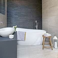 small bathroom design ideas uk use the same tiles on the floor and ceiling small