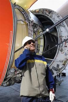 Airplane Mechanic Airplane Mechanic With Large Jet Engine Turbine Stock