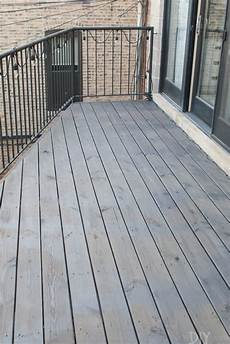 Light Or Dark Deck Stain How To Clean And Stain A Deck A Dark Gray Color The Diy