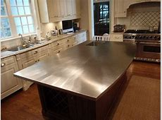 Stainless steel kitchen island with integral sink and curved front edge.   Cheap kitchen remodel