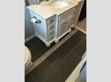 Galvano charcoal floor tiles in the bathroom. 12x24 porcelain tile with marble mosaic inlay. in