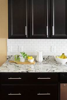 how to install kitchen backsplash tile how to install a backsplash the budget decorator