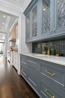 gray bar cabinets with gold pulls transitional
