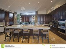 Spacious Kitchen With Stools At Island In House Stock Photo   Image of faucet, luxury: 33901798
