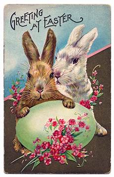 easter graphic bunnies with egg and flowers the