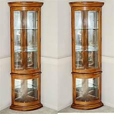Light Oak Corner Display Cabinet Pair Of Lighted Curved Glass Corner Display Cabinets Ebth
