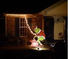 The Grinch Pulling Down Lights Grinch Encompassingchaos