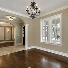 dark wood floors and white baseboards window trim paint