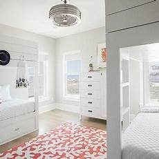white bunk beds with pink pillows transitional s room