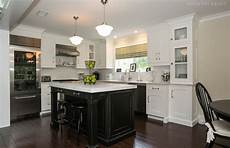 white kitchen with island black kitchen island and white cabinets in chatham nj