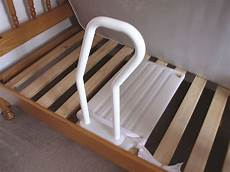 bed rail 2 in 1 for use with a divan or slatted bed