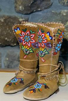 pair of colorfully beaded cree high top moose hide