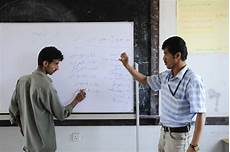 Scholarships For Hearing Impaired Students A Teacher Works With A Hearing Impaired Student A