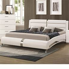 white wood california king size bed a sofa