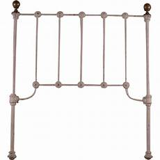 late 1800 s cast iron childs headboard with brass finials