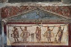 fresco of gods at thermopolium in pompeii italy