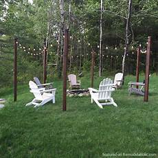 String Light Post Remodelaholic Easy Diy Outdoor Lighting Around A Fire Pit