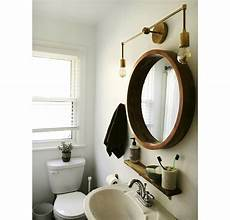 One Light Fixture Over Two Mirrors Magazine In Bathroom 1024x1024 Jpg V 1499744916