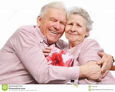 Elderly Images Free Smiling Elderly Couple And Box With Gift Stock Image