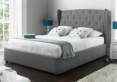 richmond upholstered winged ottoman storage bed ottoman
