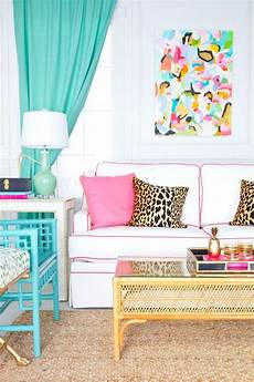 colorful living room with white sofa with pink piping