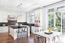 black kitchen backsplash white kitchen cabinets with black brick tile backsplash