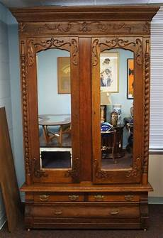 antique carved oak knockdown armoire mirrored