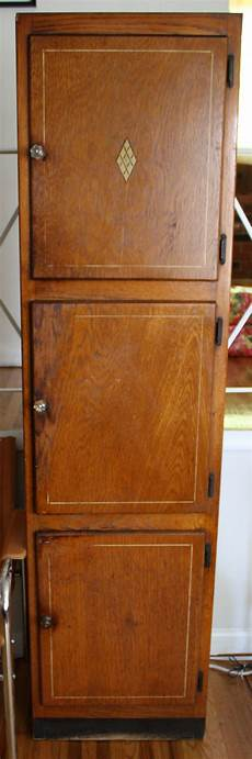 retro wood cabinet with cut glass knobs picked vintage