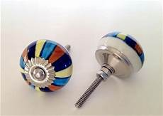 colorful blue mixed stripes on porcelain cabinet knobs