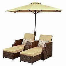 dual loungers with umbrella and table patio