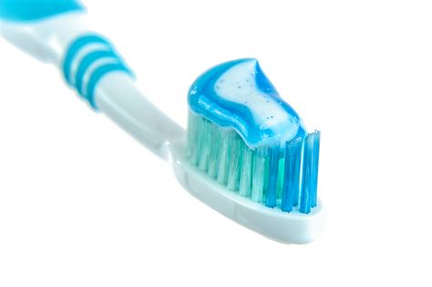 And Toothpaste blue and white toothpaste on toothbrush 183 free stock photo