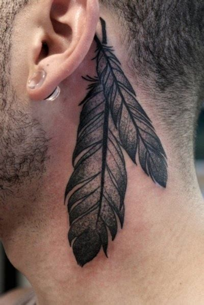 raven feather tattoo designs usually has feathers tattooed on him