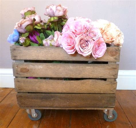 Magnolia Homes vintage wooden apple crates on wheels castors