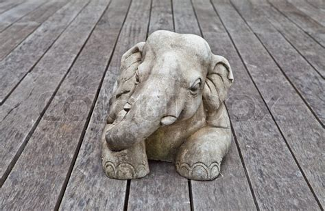 elephant sculpture on a wood board floor stock
