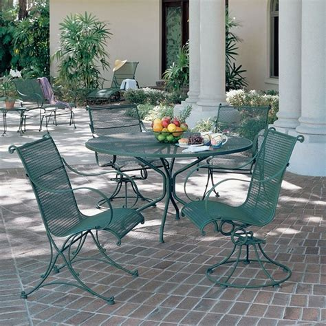 how to clean wrought iron patio furniture furniture wrought iron patio table also chairs in green paramitopia wrought iron patio
