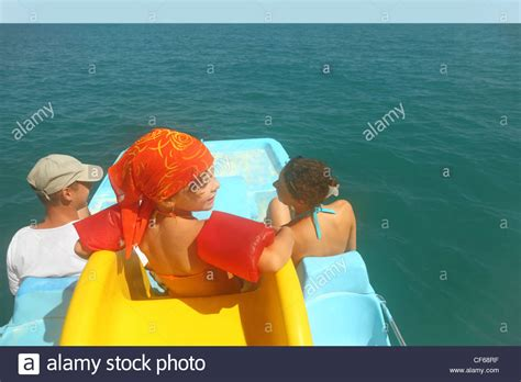 pedal boat yellow family with girl on pedal boat with yellow slide in sea
