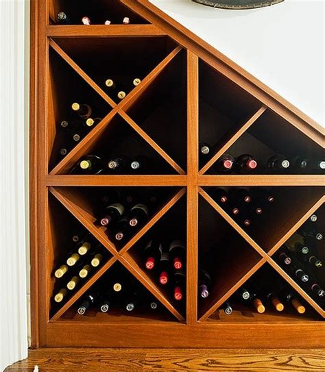 wine storage under stairs make use of dead space under the stairs