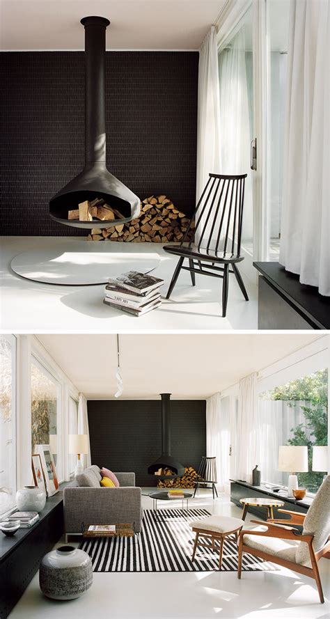 hanging fireplace a hanging fireplace and black accent wall stand out in